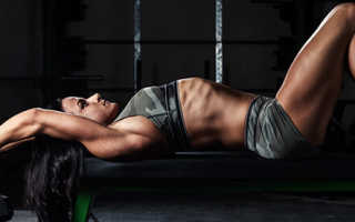 Pullover lying on a bench with a dumbbell and barbell